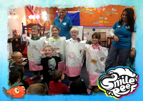 Smile Reef Dental Staff Teaching Children During Dental Awareness Month